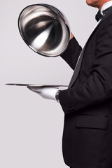 Butler and silver service