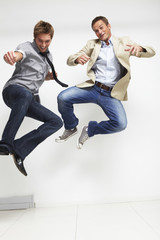 Two men jumping