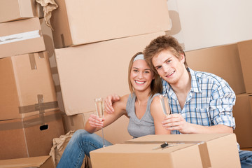 Moving house: Happy man and woman celebrating