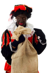 Zwarte Piet ( black pete) typical dutch character with bag
