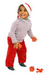 Niño mulato de 18 meses de edad con motivos navideños
