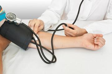 medicine concept. doctor measures pressure in the patient