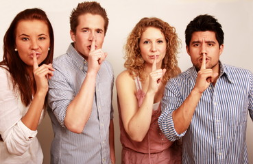 Secretive group with finger on lips