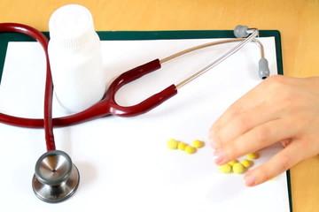 Hand taking pills