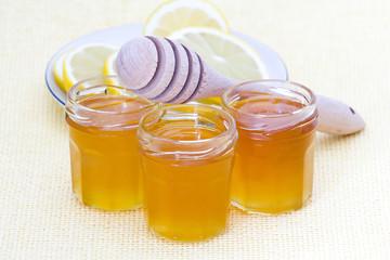 honey, lemon and wooden drizzler