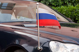 Car of Russian Diplomatic Corps to the flag of Russia