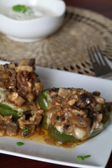 Baked stuffed peppers with mushrooms and cheese