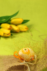 Easter egg with decoration and tulips