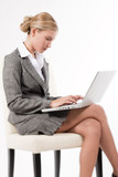 Beautiful business woman working on her laptop