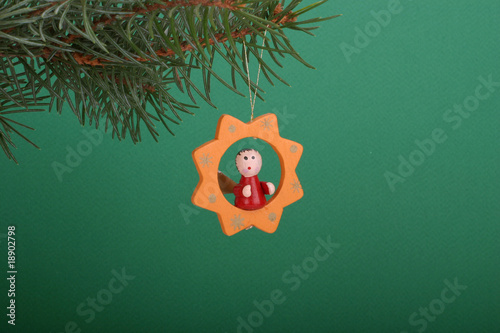 Christmas angel on green background