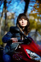 The brunette girl on the red motorcycle