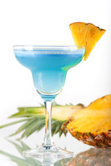 Blue alcohol cocktail with pineapple