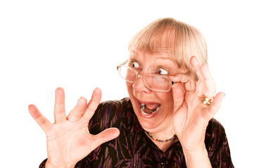 Shocked senior woman looking over the top of her glasses