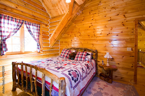 Close up on a Bedroom in a Cabin - 18912319