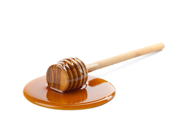 wild honey and wooden dipper isolated