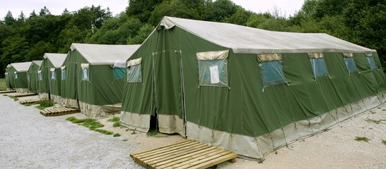 Green tent camp in Pyrenees for  Santiago pilgrims