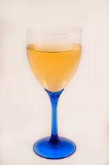 Glass of white wine on a white back ground