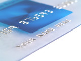 A closeup of a mock Credit Card with Your Name Here poster