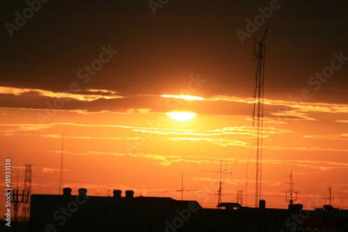 Leinwanddruck Bild Sunset over city buildings, Thailand.