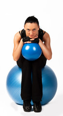 Athlete doing stretching exercise with ball
