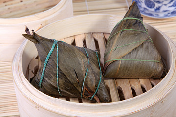 Chinese rice dumplings over bamboo basket