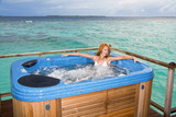 woman in jacuzzi on background of ocean, watar villa, Maldives poster