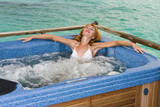 girl in a jacuzzi against ocean poster
