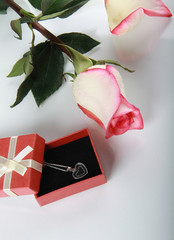 Rose and gift with jewelry decoration
