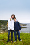 Children standing at Atlantic coast in Newfoundland poster