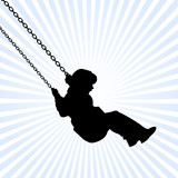 kid playing on a swing attached on chain