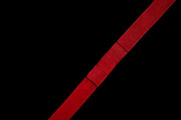 Red ribbon on black background