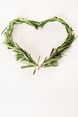 rosemary sprigs heart with copyspace