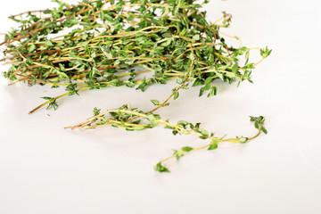 fresh thyme sprigs on white