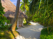 Bungalows on beach and sand pathway
