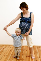 pregnant woman and little boy