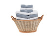 Wicker laundry basket full of white and gray towels - 18973728
