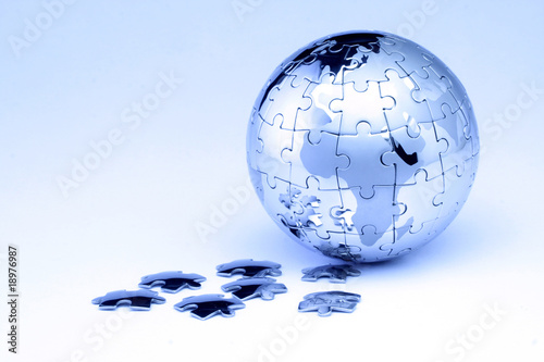 Jigsaw globe puzzle on white