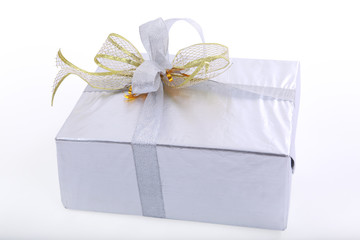 A gold boxed gift with gold ribbon.