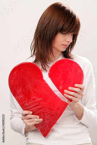 Young beauty woman with broken heart