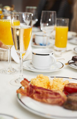 Prepared table with champagne and juice