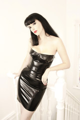 a stunning looking woman posing in latex fetish clothing