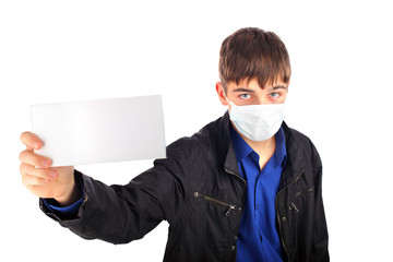 teenager in the flu mask with blank paper