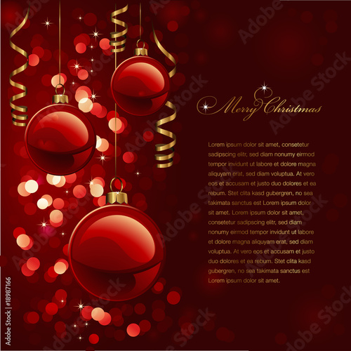 christmas background with red baubles and defocused lights
