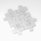puzzle pieces with currency signs