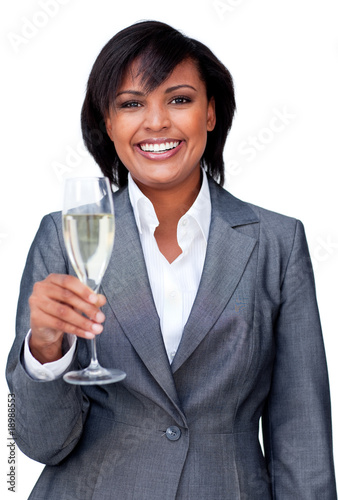 Smiling businesswoman celebrating a success with Champagne