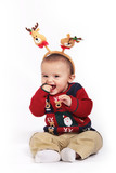 Happy baby wearing antlers isolated