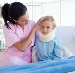A nurse looking after an upset girl with a neck brace