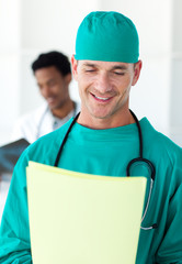 Attractive surgeon looking at a patient's folder