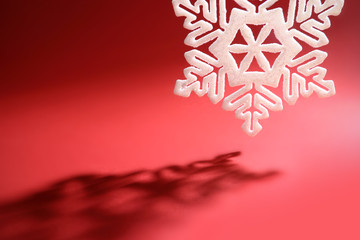 snowflake against red