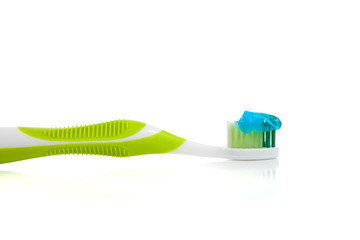 Lime green toothbrush and toothpaste on white